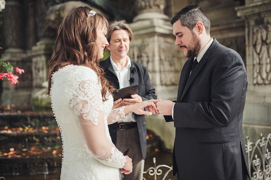 the groom slides the ring