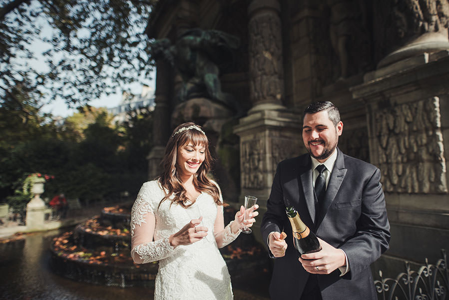 groom opens the champagne bottle